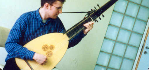 Photograph of a musician playing an early string musical instrument