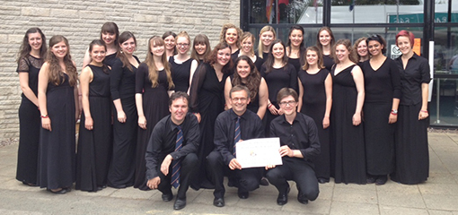 University Women's Choir win the Female Choirs competition and compete for the Choir of the World trophy.