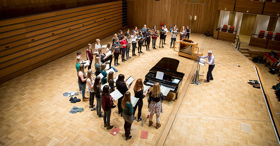 University-Women's-Choir-in-rehearsal-with-Professor-Simon-Carrington