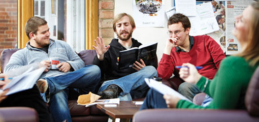 Photograph of relaxed postgraduates in an informal setting