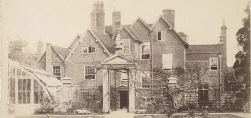 Photograph of the rear of Mason Croft with an arched gateway