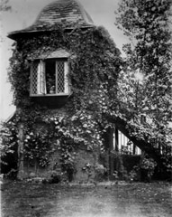 Photograph of a watchtower covered in Ivy