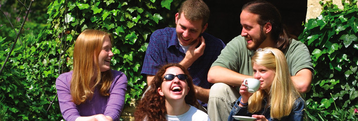 Photograph of laughing students in the Shakespeare Institute garden