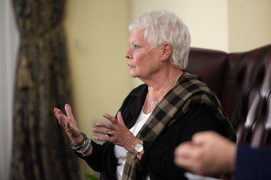 Dame Judi Dench speaking at an event