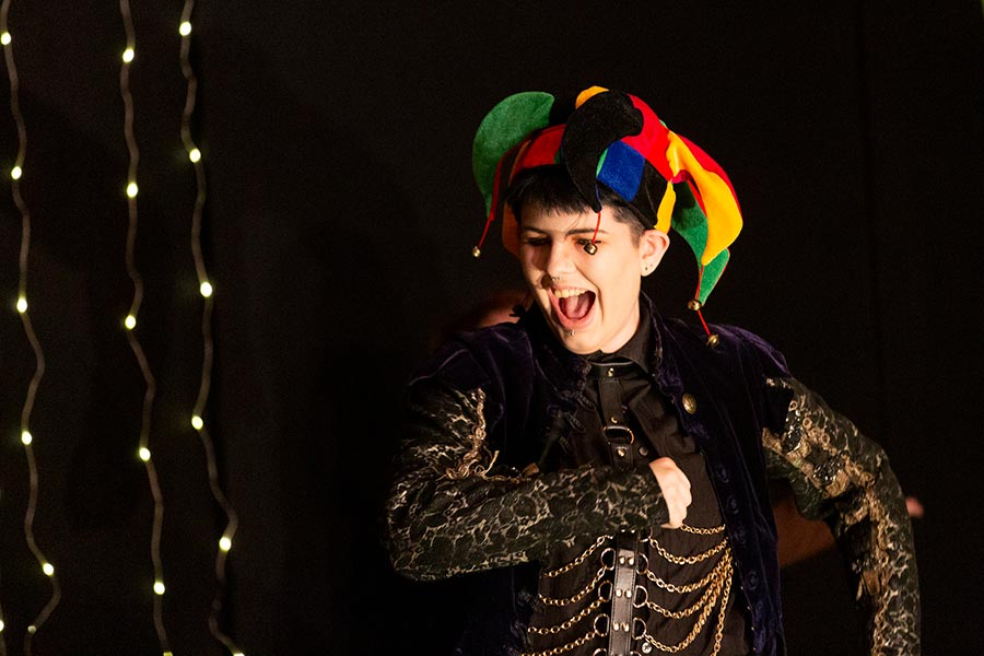Student performer wearing jester's hat