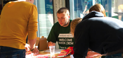 Photograph of students at a Welcome Week desk