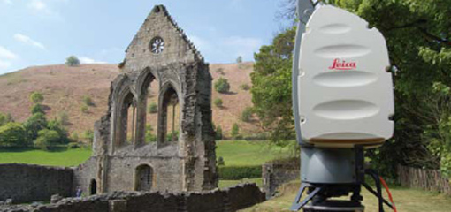 Photograph showing 3D laser scanning equipment and the remains of an abbey wall