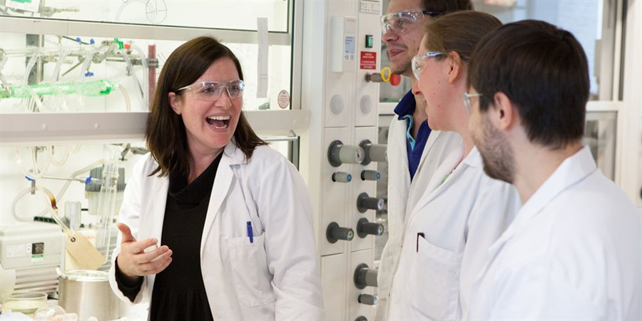Photo of Professor Rachel O'Reilly in a laboratory laughing with colleagues