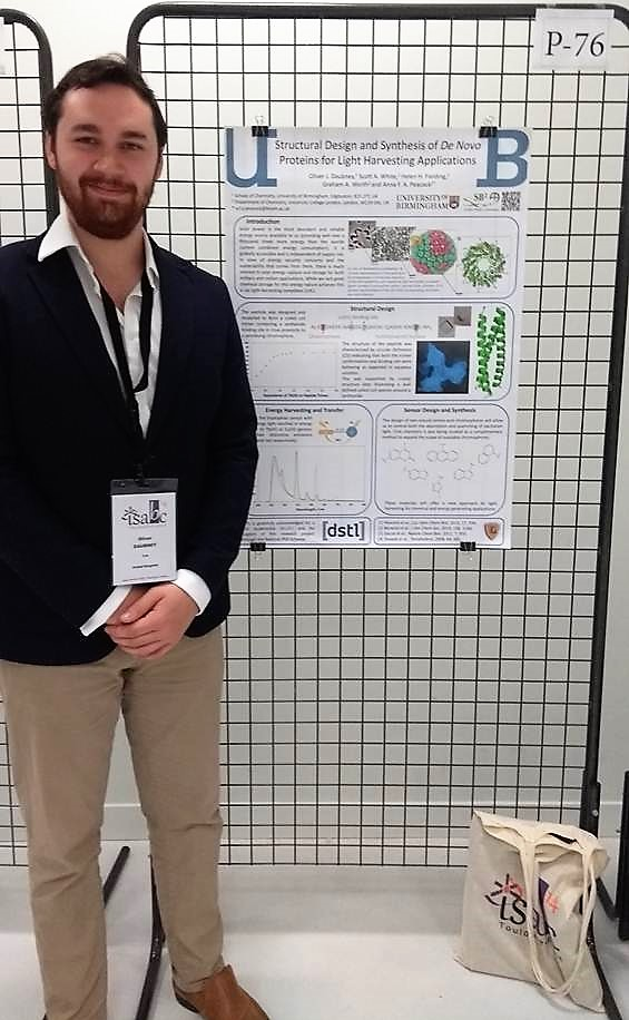 Universiy of Birmingham PhD student Oliver Daubney standing next to his prize-winning poster at the 2017 ISABC symposium
