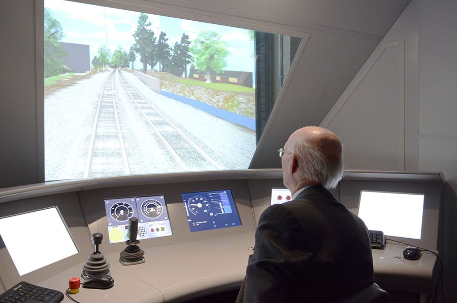 Lord Brior of Brampton using a train simulator at the Birmingham Birmingham Centre for Railway Research and Education
