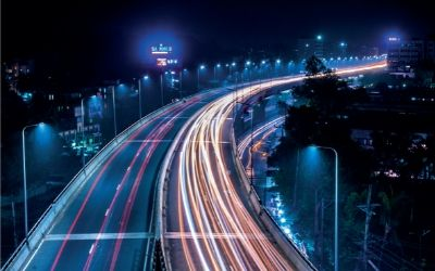 image of sky view of busy road at night with bright lights