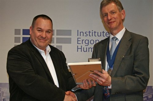 Professor Chris Baber receiving the Sir Frederic Bartlett medal from President of the IEHF, Dr. Richard Graveling, at the Annual Conference.