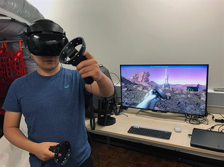 User wearing VR headset interacting with planetary survival demo