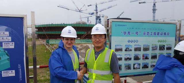 Jonny with Professor Zhu (the organiser) in front of the construction site of Fuqing Nuclear Power Plant