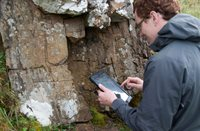 Earth Sciences student using tablet