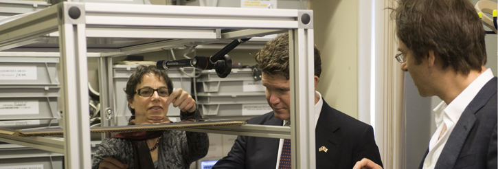 The US ambassador is shown some of the Centre equipment