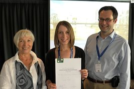 Leah Bull (Centre) is presented with the Society for the Study of Behavioural Phenotypes Pat Howlin prize by Prof. Pat Howlin (Left) and Dr Petrus de Vries (Right)