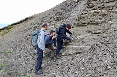 photo of group taking rock samples