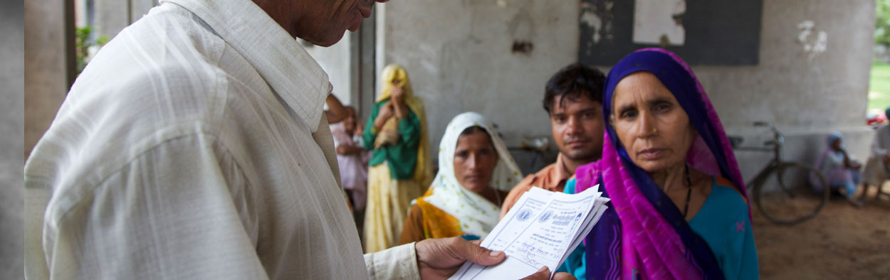 Doctor reading patient notes with a female patient in Indian clinic