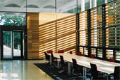 Photo of interor of NMR building, showing tables and sunlight through a window with blinds
