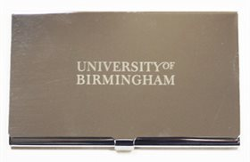 silver business card holder with University of Birmingham engraved on it