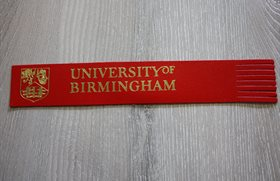 red bookmark with University of Birmingham embossed on it