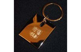 silver keyring with the university crest engraved on the side