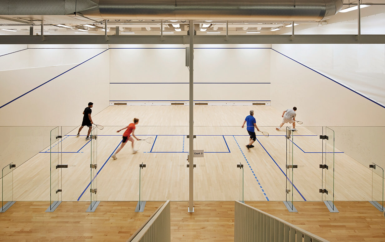 Two squash matches taking place in the University of Birmingham Sport and Fitness Centre.