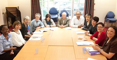 Members of the Commission and the NYRG at a Commission meeting