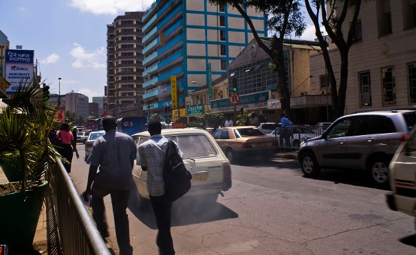 Heavy traffic in Nairobi showing emissions coming from a car