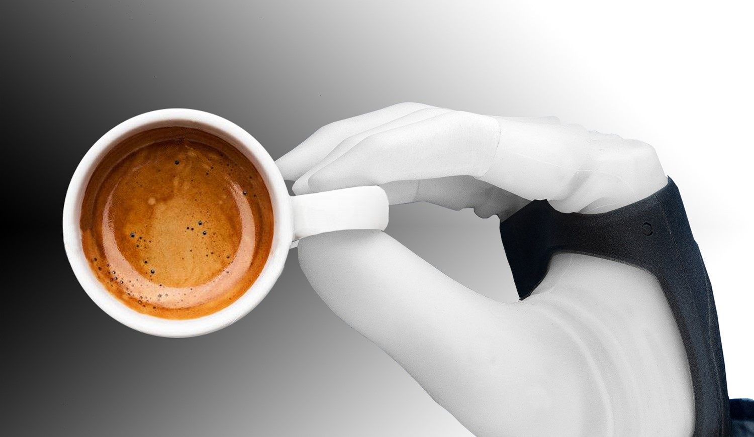 Robotic hand grasping an espresso cup