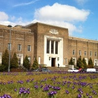 Exterior shot of the University of Birmingham Medical School on a nice day in spring