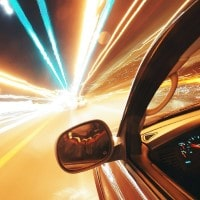 Abstract image of car in tunnel with lights above