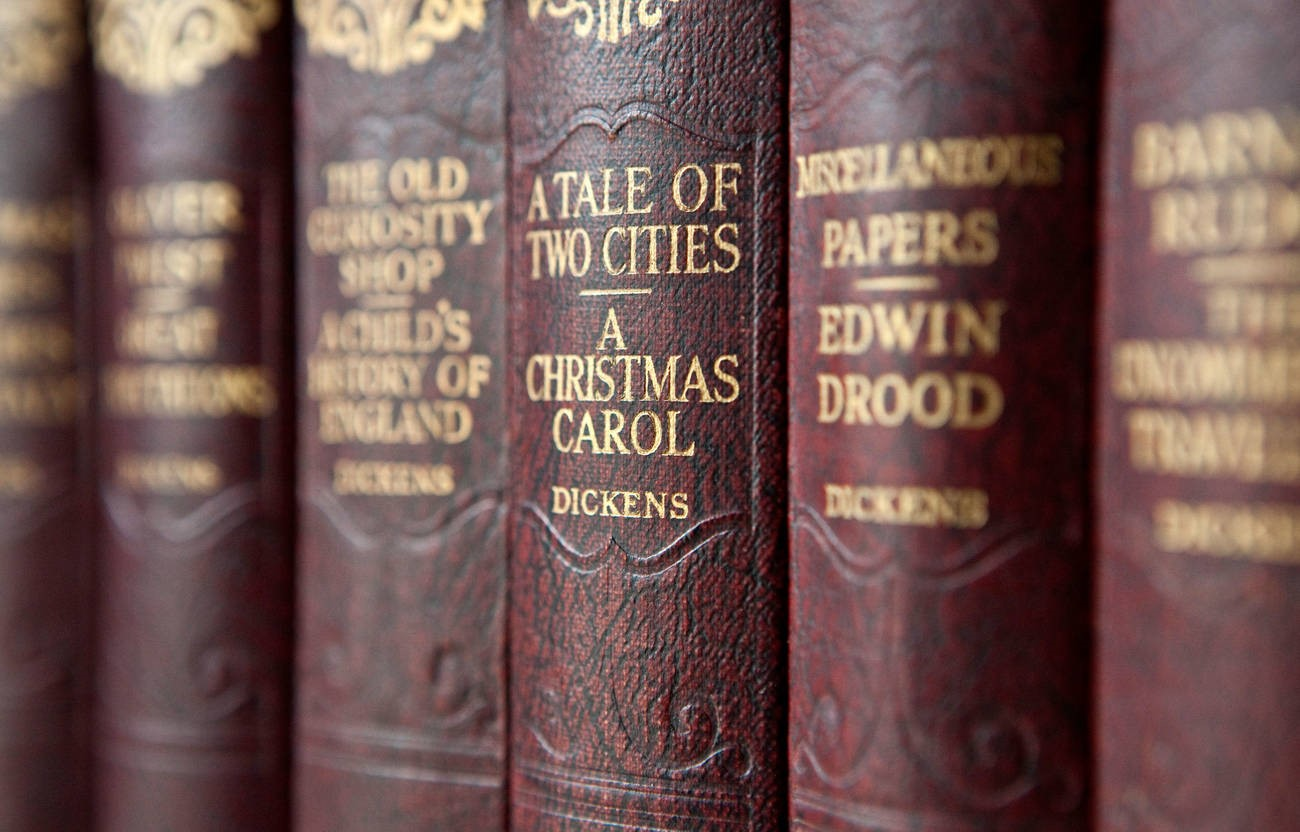 Row of Dickens book on a shelf