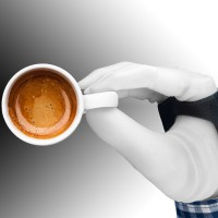 Robot hand grasping coffee cup
