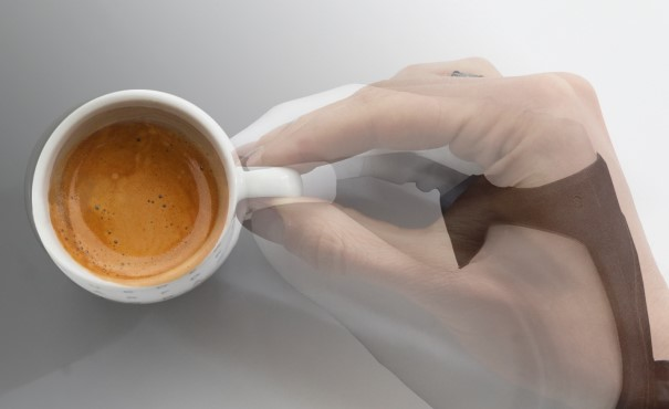 Robotic and human hand superimposed grasping a coffee cup