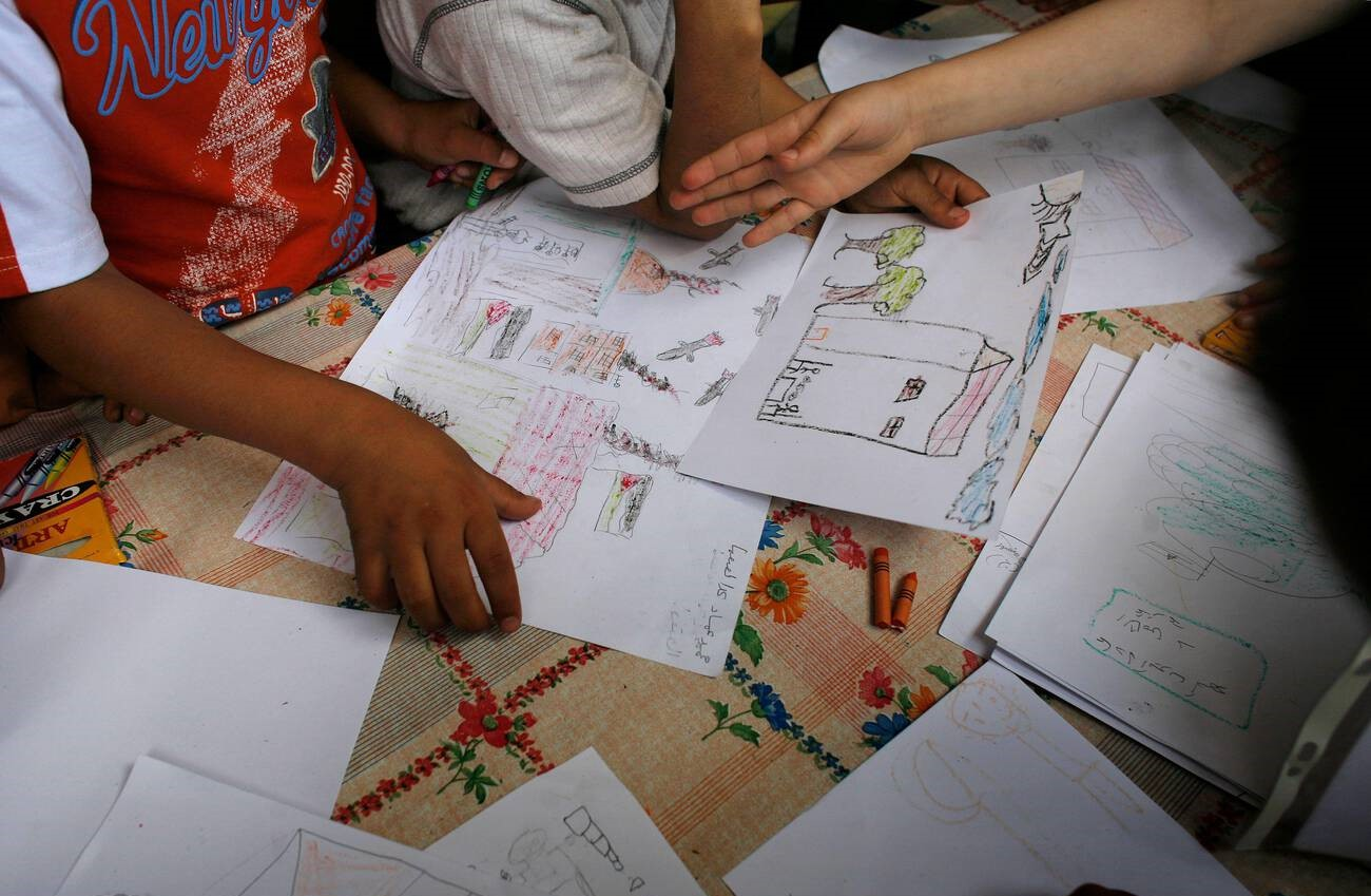 Children make drawings at Baddawi camp