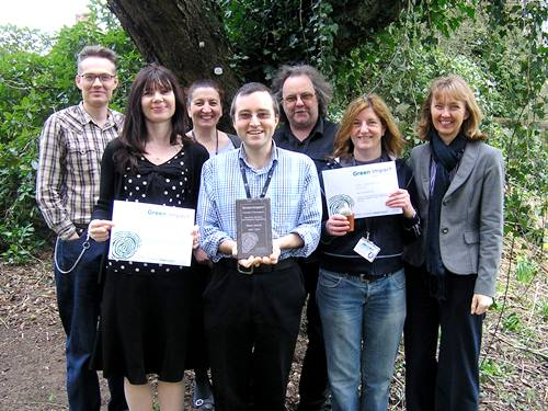 Some of the Schools Green Impact team with the Silver and Gold awards earned in 2013