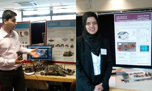 Two final year MEng students showing their project work