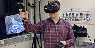 Man using Virtual Reality headset and hand controllers