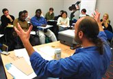 Photograph of a lecturer teaching a small group