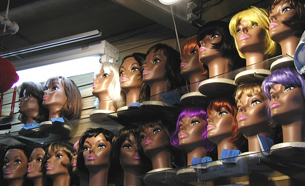 Mannequin heads in a shop.
