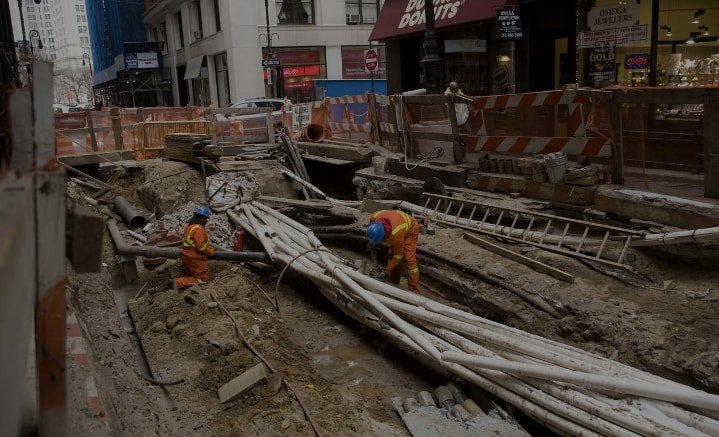 Workmen working on underground infrastructure