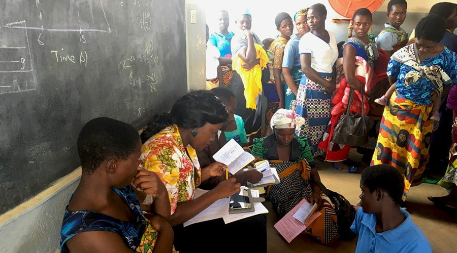 Women queue to see health workers
