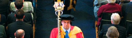 Mace bearer leading a degree congregation procession