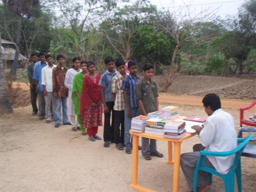 prof-indrajit-ray-distributing-books