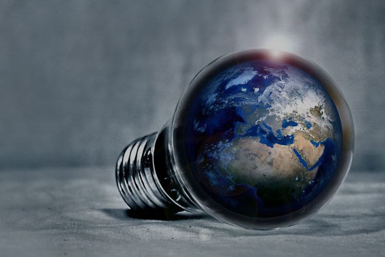 Conceptual image of earth inside a light bulb