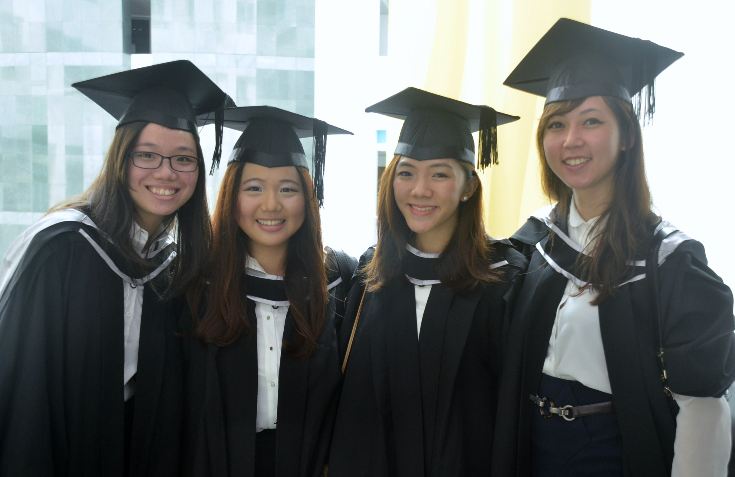 Singapore students celebrate graduating last year from the Singapore ...