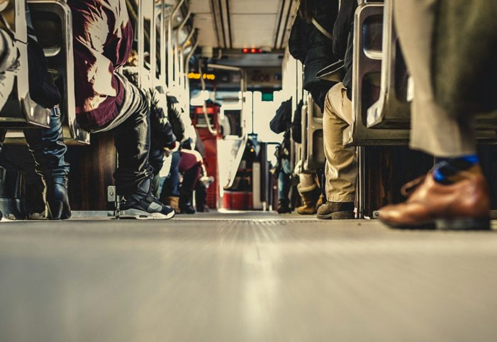 Low angle shot of people on a crowded train
