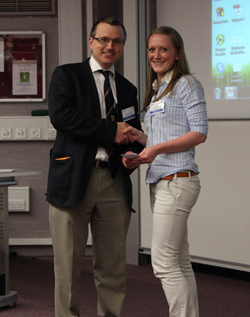 Jamie Coleman collects her prize
